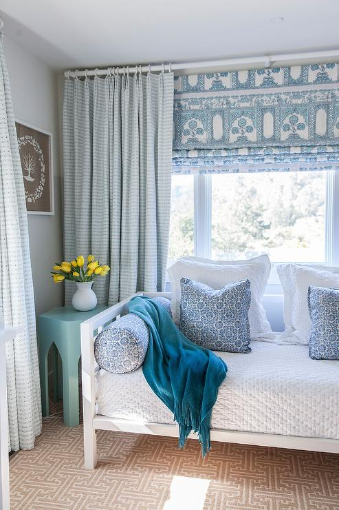 wisteria-french-blue-moroccan-table-white-daybed-peacock-blue-throw